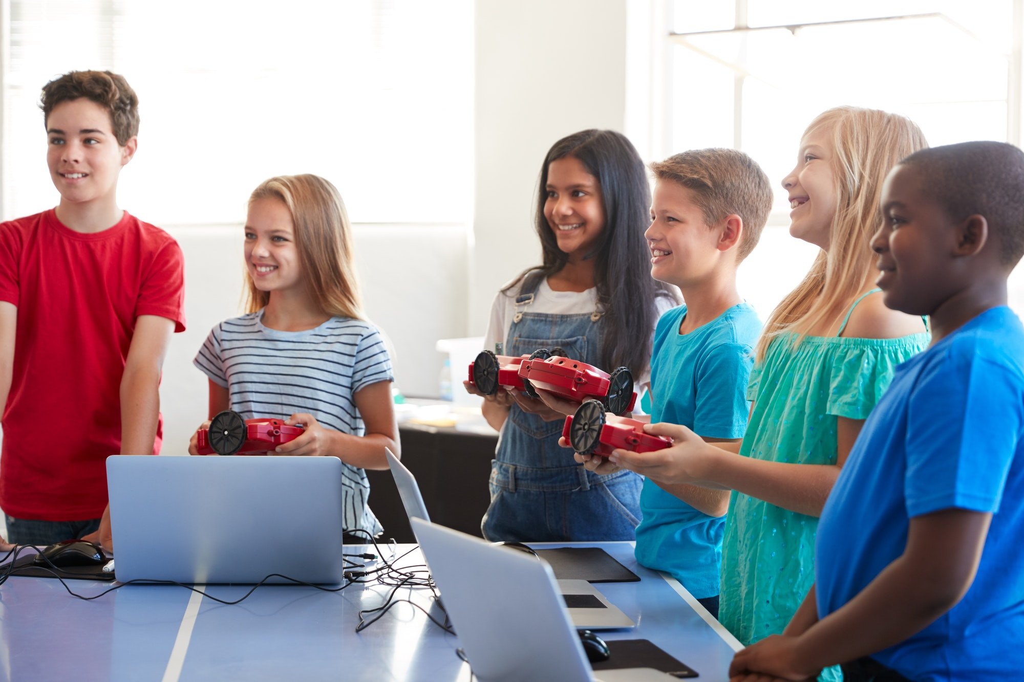 group-of-students-in-after-school-computer-coding-class-learning-to-program-robot-vehicle-1-1.jpg
