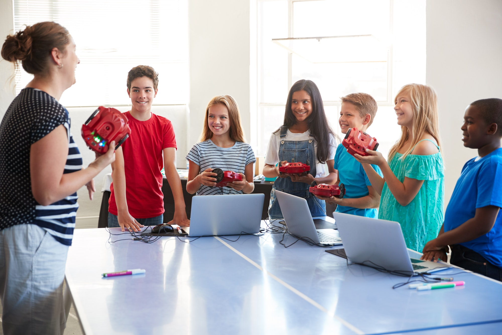 group-of-students-in-after-school-computer-coding-class-learning-to-program-robot-vehicle-10.jpg