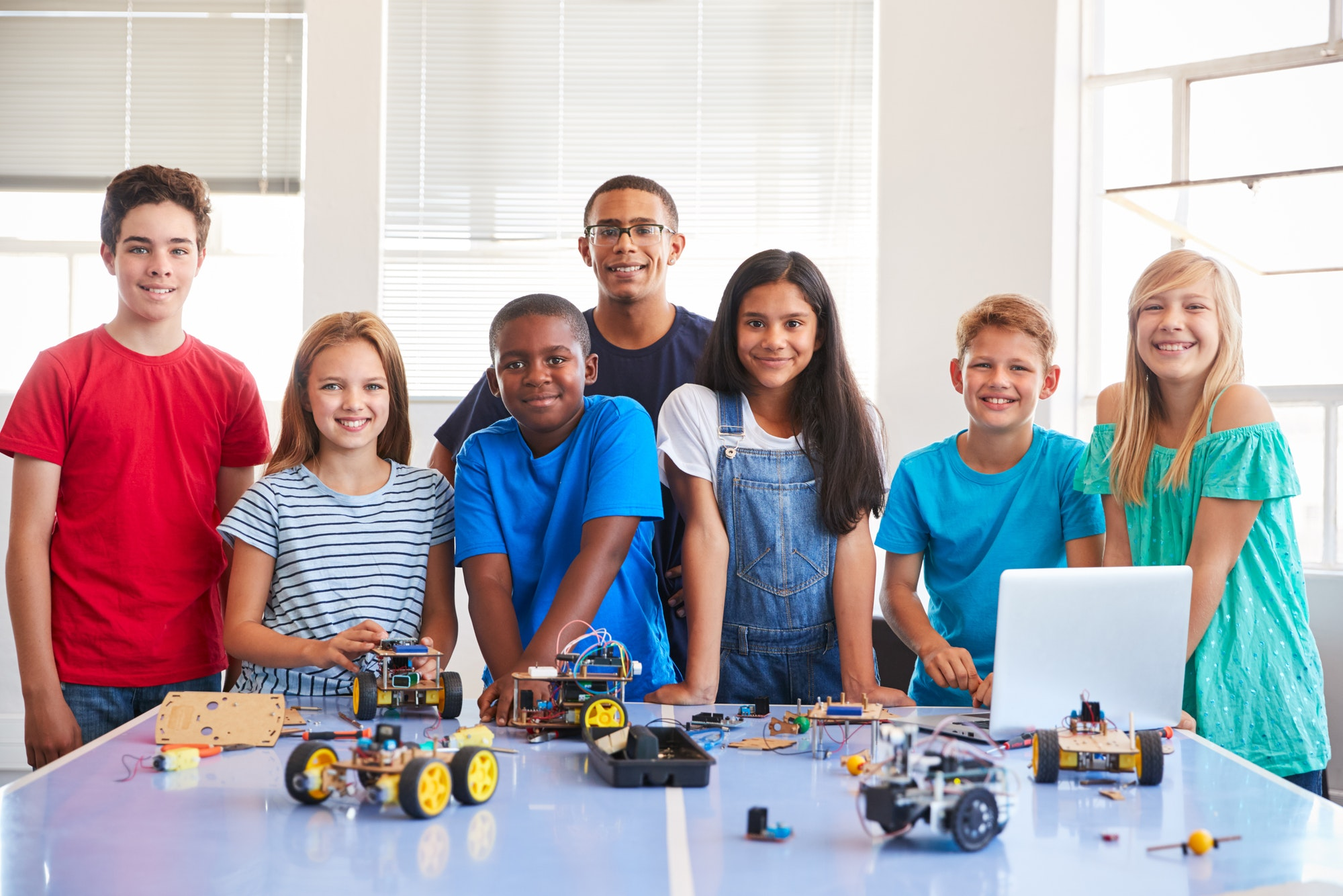 portrait-of-students-with-teacher-building-robot-vehicle-in-after-school-computer-coding-class.jpg