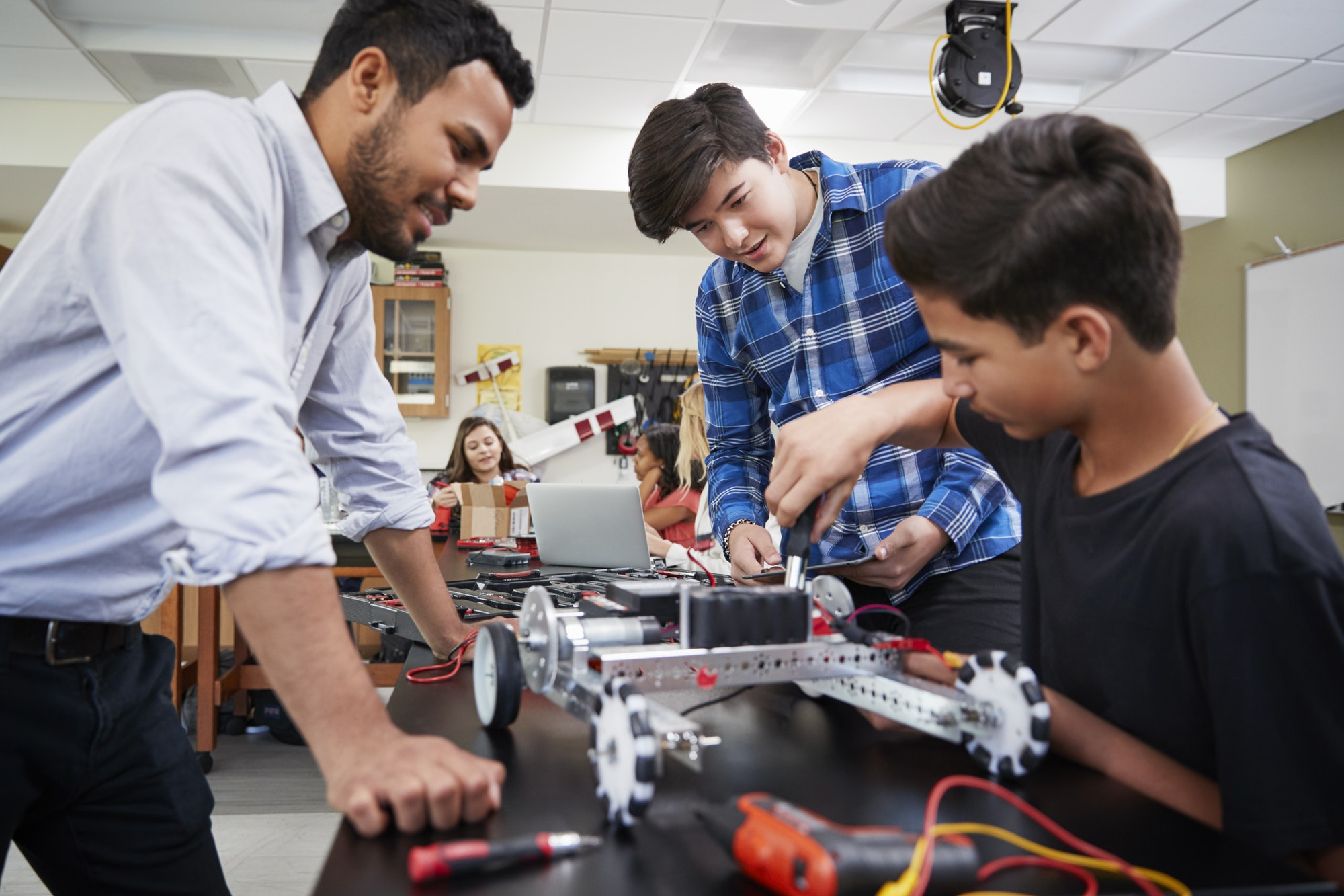teacher-with-male-pupils-building-robotic-vehicle-in-science-lesson.jpg