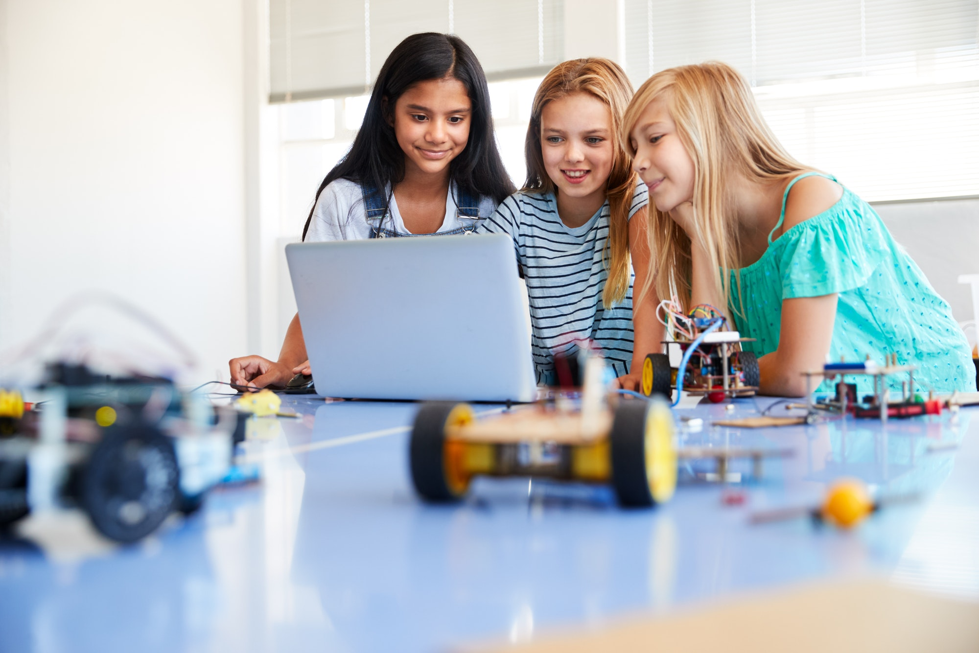 three-female-students-building-and-programing-robot-vehicle-in-after-school-computer-coding-class-2.jpg